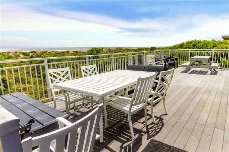 beautiful rooftop deck with views of water