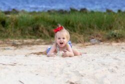 little girl in sand