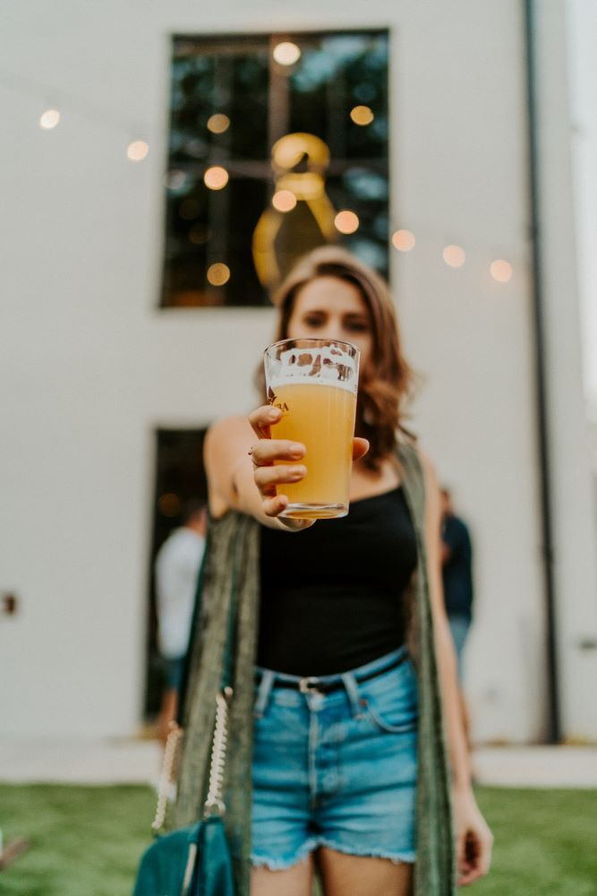 woman holding a beer